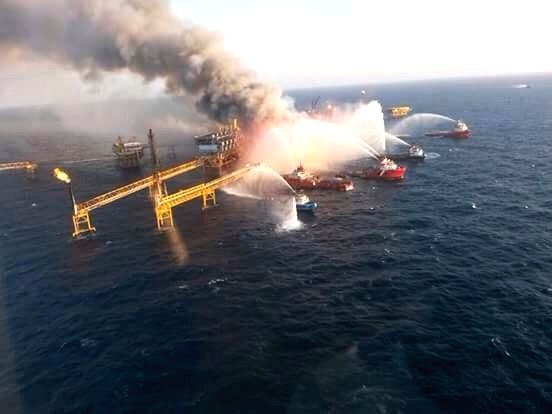 Boats try to douse a fire of the oil platform Abkatun, in Campeche Bay on the Gulf of Mexico, on April 1, 2015. Mexican state-run oil company Pemex said on ...
