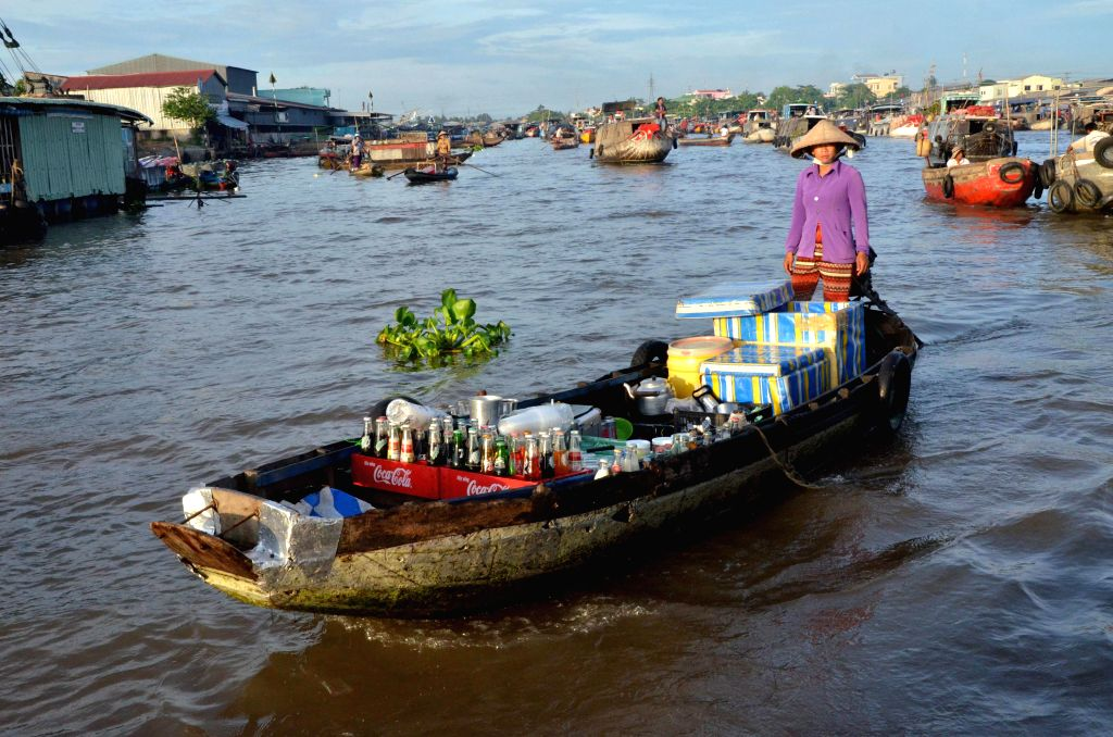 CAN THO, June 22, 2016 - A local vendor sells beverage at a floating market in Can Tho, southern Vietnam, June 21, 2016. Located some 170 km southwest of Ho Chi Minh City in the Mekong Delta region, ...