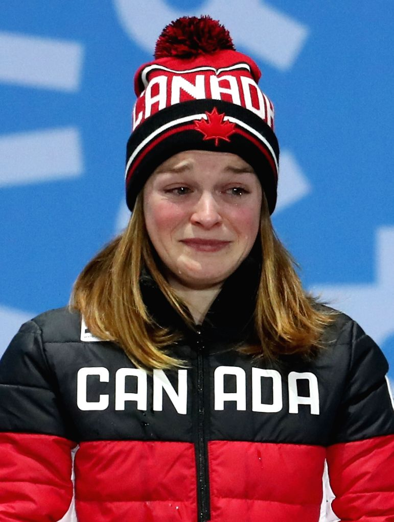 Canadian speed skater Kim Boutin, the bronze medalist in women's 500-meter race in the PyeongChang Winter Olympics, tears up at the medals podium during the victory ceremony in the ...