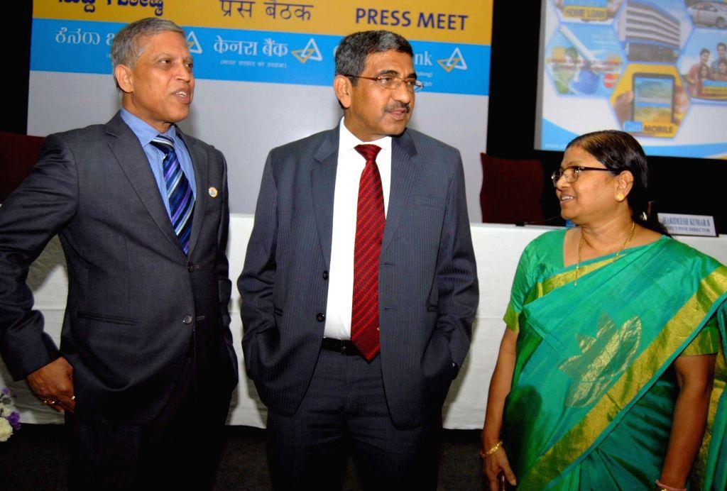 Canara Bank Managing Director and CEO Rakesh Sharma with Executive Directors Dina Bandhu Mohapatra and PV Bharathi during a press conference in Bengaluru, on Oct 26, 2016. - Rakesh Sharma