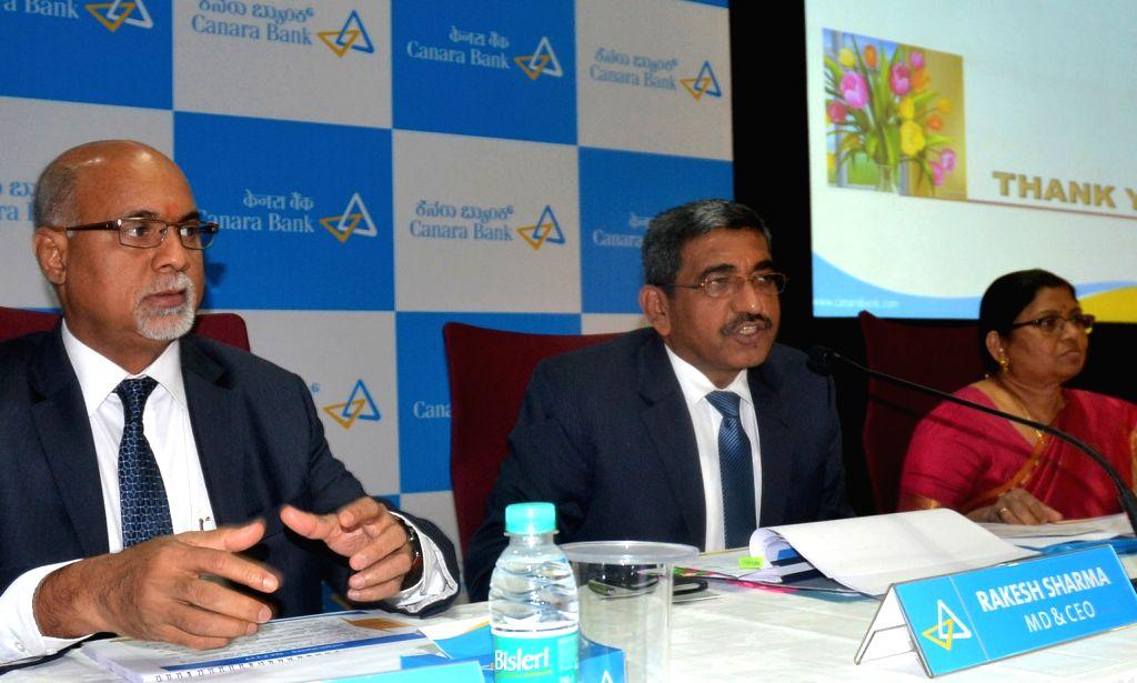Canara Bank Managing Director and CEO Rakesh Sharma with Executive Directors Dina Harideesh Kumar and PV Bharathi addresses a press conference at Canara Bank Head Office in Bengaluru on ... - Rakesh Sharma and Dina Harideesh Kumar