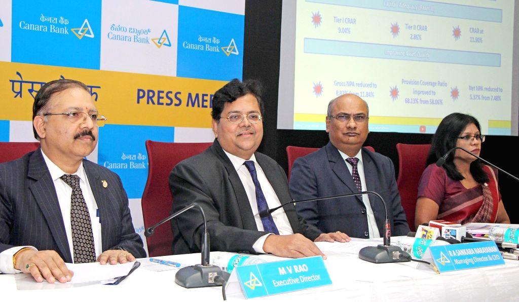 Canara Bank MD and CEO RA Sankara Narayanan with Executive Directors Debhashish Mukherjee, Manimekhalai and MV Rao addresses a press conference to announce financial results for the fourth ... - Debhashish Mukherjee
