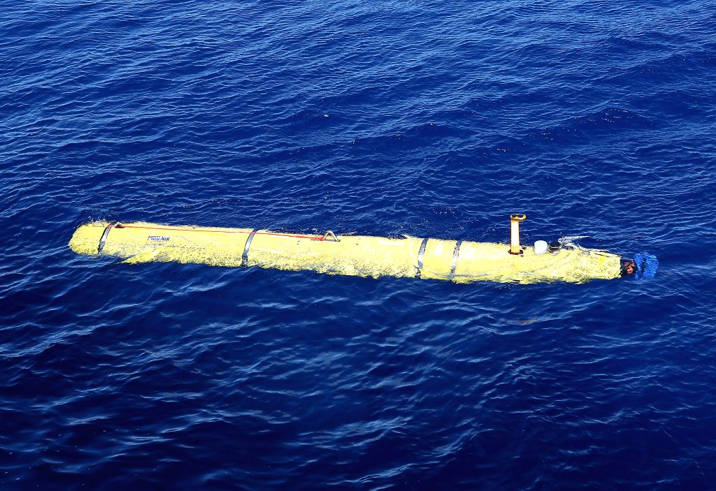Photo released by the Australian Defense Department on April 17, 2014 shows Phoenix International Autonomous Underwater Vehicle (AUV) Artemis begins its dive in ..