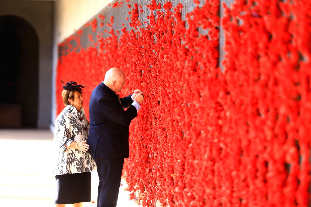 CANBERRA, April 25, 2019 - Australia's Governor-General Peter Cosgrove(R) takes part in an ANZAC Day ceremony at Australian War Memorial in Canberra, Australia, on April 25, 2019. Celebrated on April ...