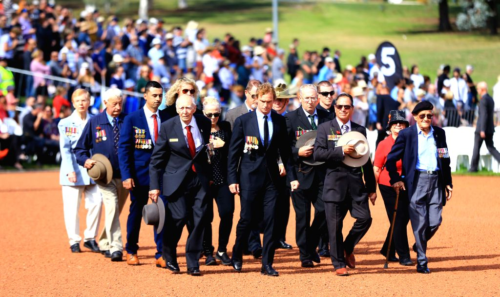 CANBERRA, April 25, 2019 - Veterans and their descendants march during an ANZAC Day ceremony at Australian War Memorial in Canberra, Australia, on April 25, 2019. Celebrated on April 25 every year, ...