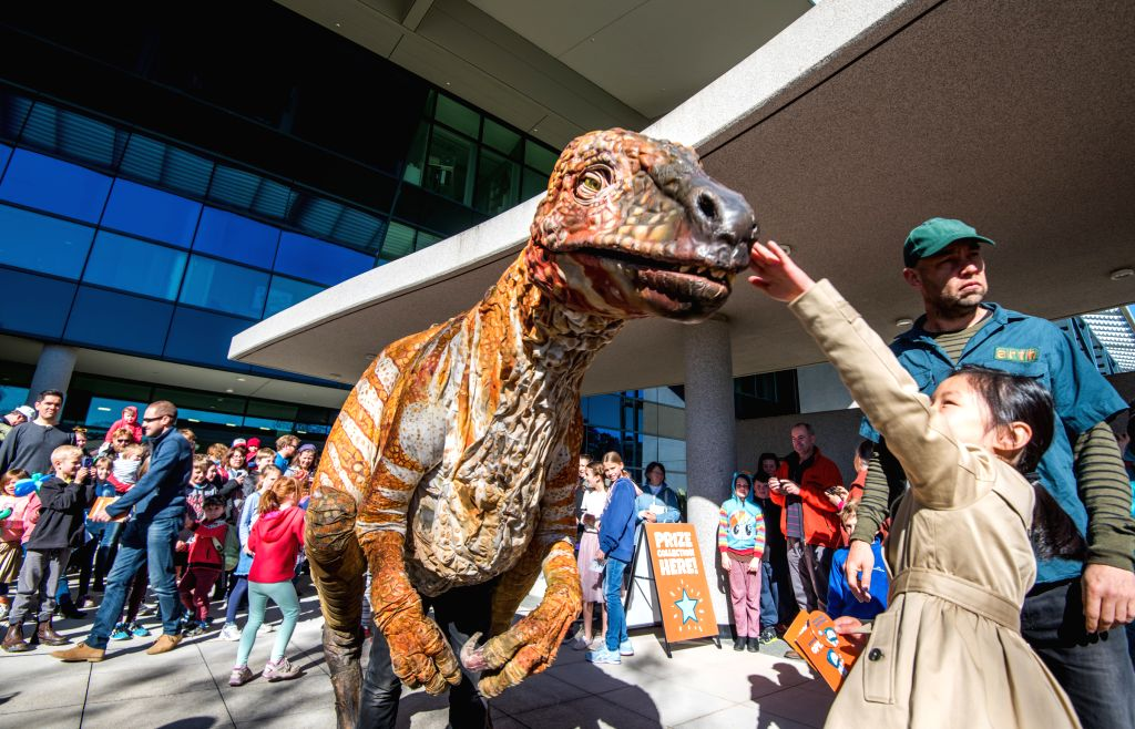 CANBERRA, Aug. 20,2017 - A simulation dinosaur attracts visitors' attention in Geoscience Australia on the Geoscience Open Day in Canberra, Australia, on Aug. 20, 2017.