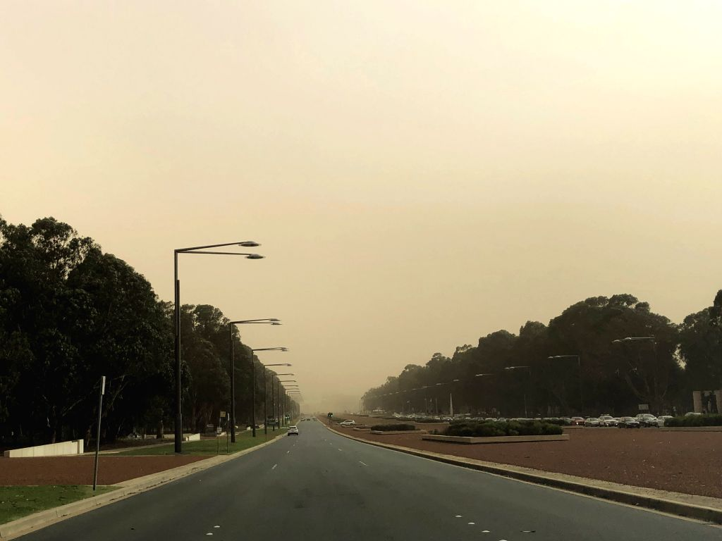CANBERRA, Feb. 12, 2019 - Photo taken on Feb. 12, 2019 shows a road shrouded in dust in Canberra, Australia. A dust storm swept Canberra Tuesday afternoon.