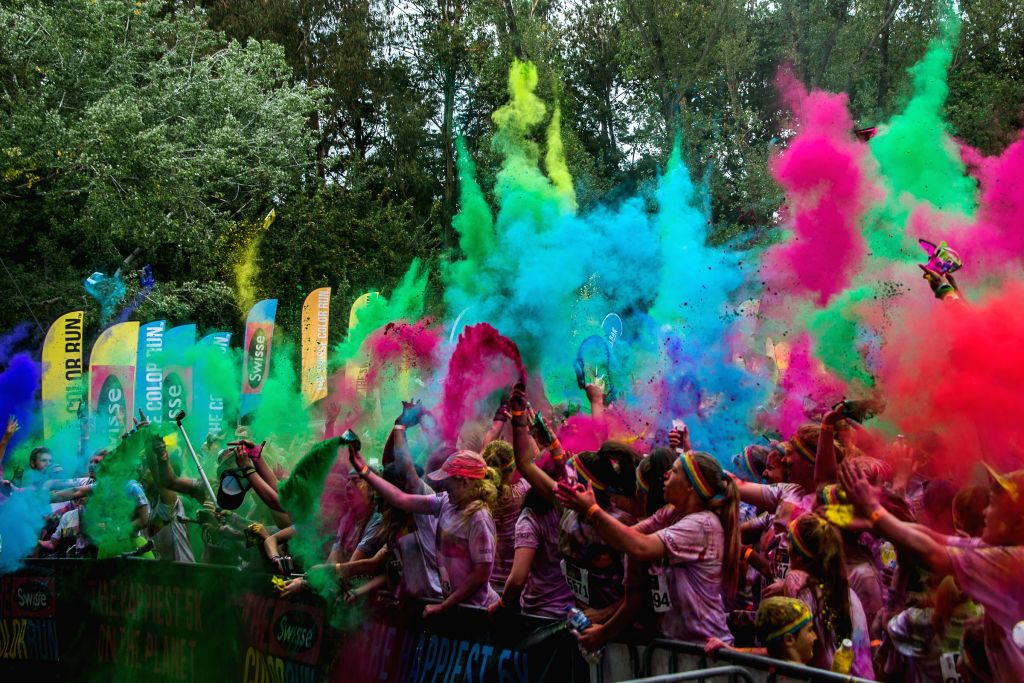 """Runners take part in the 5km Color Run at Commonwealth Park in Canberra, Australia, Feb. 22, 2015. Some 7,000 runners finished this year's """"Color Run"""" ..."""