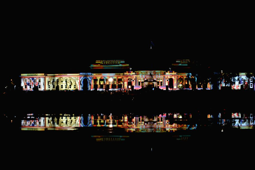 """Old Parliament House of Australia is illuminated by projection in Canberra, Australia, Feb. 27, 2015. """"Enlighten Canberra"""" is an annual cutural and ..."""