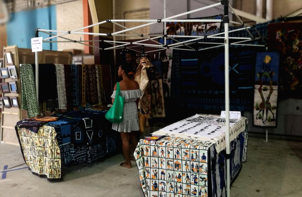 CANBERRA, Feb. 3, 2019 - Fabrics from Africa are seen at the Old Bus Depot Markets in Canberra, Australia, Feb. 3, 2019. Visitors can find multicultural products at the markets.