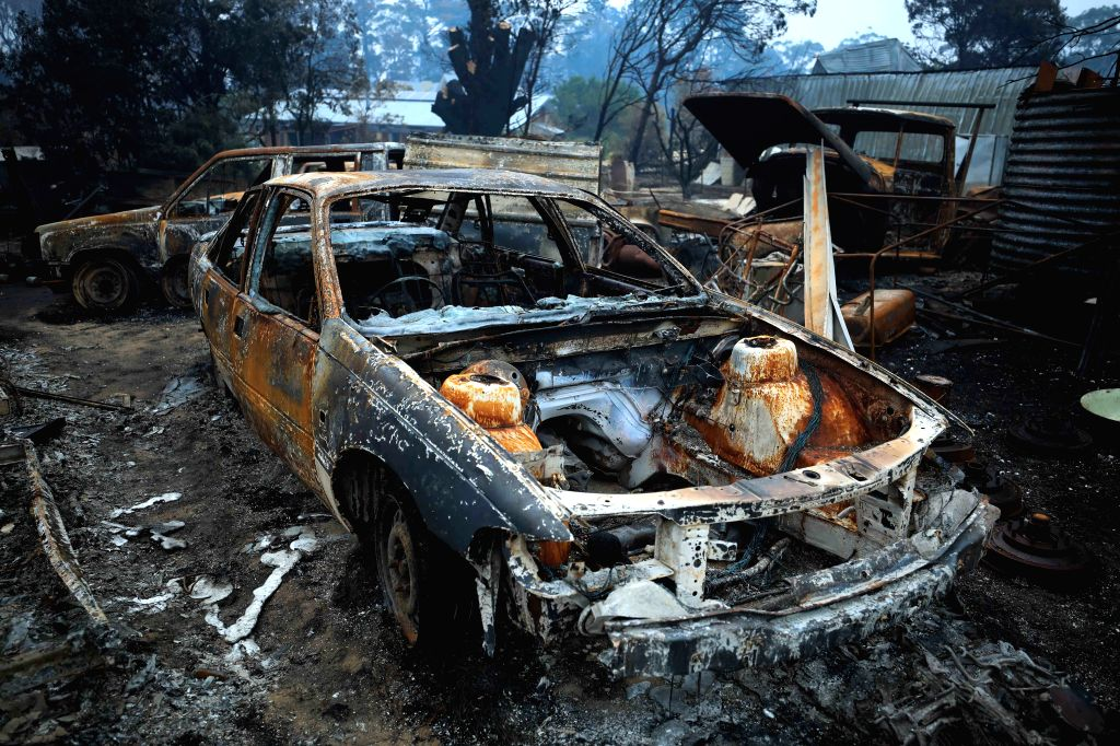 CANBERRA, Jan. 13, 2020 (Xinhua) -- Photo taken on Jan. 12, 2020 shows a burnt car left by bushfires in the village of Wingello, about one and a half hour drive from Canberra, capital of Australia. At least 28 people have died and more than 2,000 hom