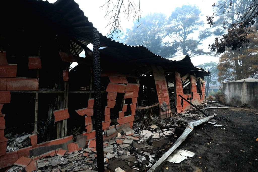 CANBERRA, Jan. 13, 2020 (Xinhua) -- Photo taken on Jan. 12, 2020 shows burnt houses left by bushfires in the village of Wingello, about one and a half hour drive from Canberra, capital of Australia. At least 28 people have died and more than 2,000 ho