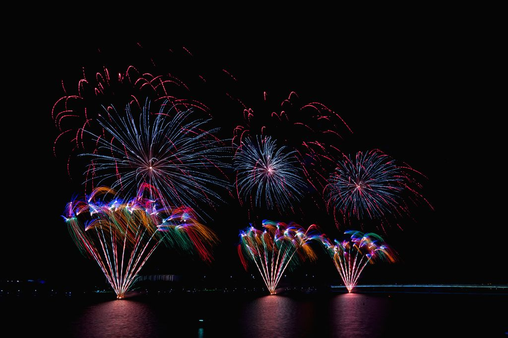 CANBERRA, Jan. 26, 2018 - Fireworks are seen by Lake Burley Griffin in Canberra, to celebrate Australia Day, the national day of Australia, Jan. 26, 2018.