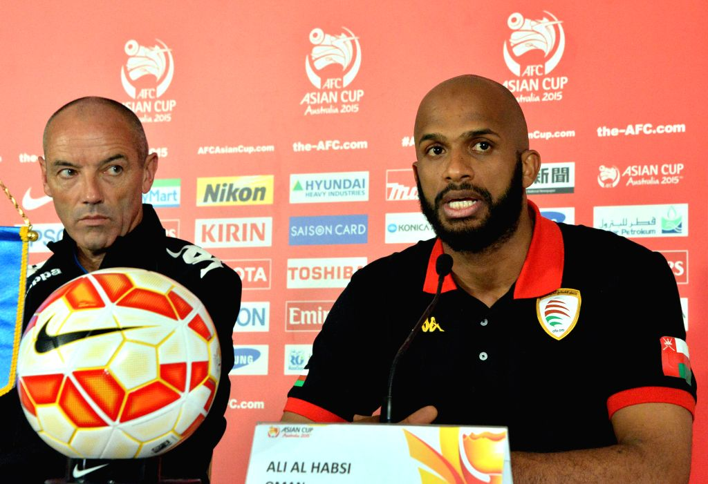 Oman's head coach Paul Le Guen (L) and team captain Ali Al Habsi attend a press conference for AFC Asian Cup at the Canberra Stadium in Canberra, Australia, Jan. 9, - Ali A