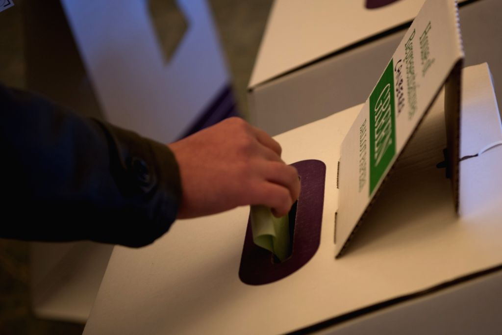 CANBERRA, July 2, 2016 - A Canberra voter casts her vote to the ballot box at a polling station in Old Parliament House in Canberra, Australia, July 2, 2016. All the 150 House of Representative seats ...