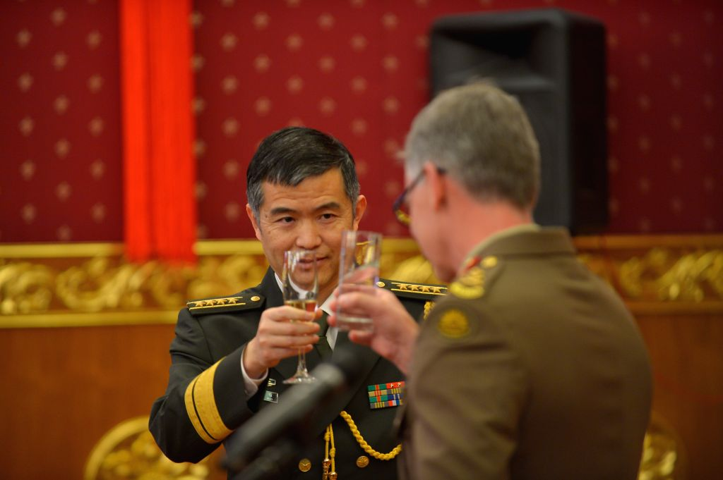CANBERRA, July 29, 2016 - Senior Colonel Wang Jingguo (L), Defence Attache of the Chinese Embassy in Australia, and Major General Rick Burr, Deputy Chief of Army of Australian Defense Forces have a ...