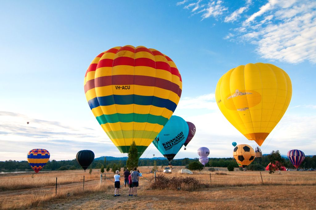 """CANBERRA, March 12, 2017 - Hot air balloons land next to the Lake Burley Griffin during """"Balloon Spectacular"""" in Canberra, Australia, March 12, 2017."""