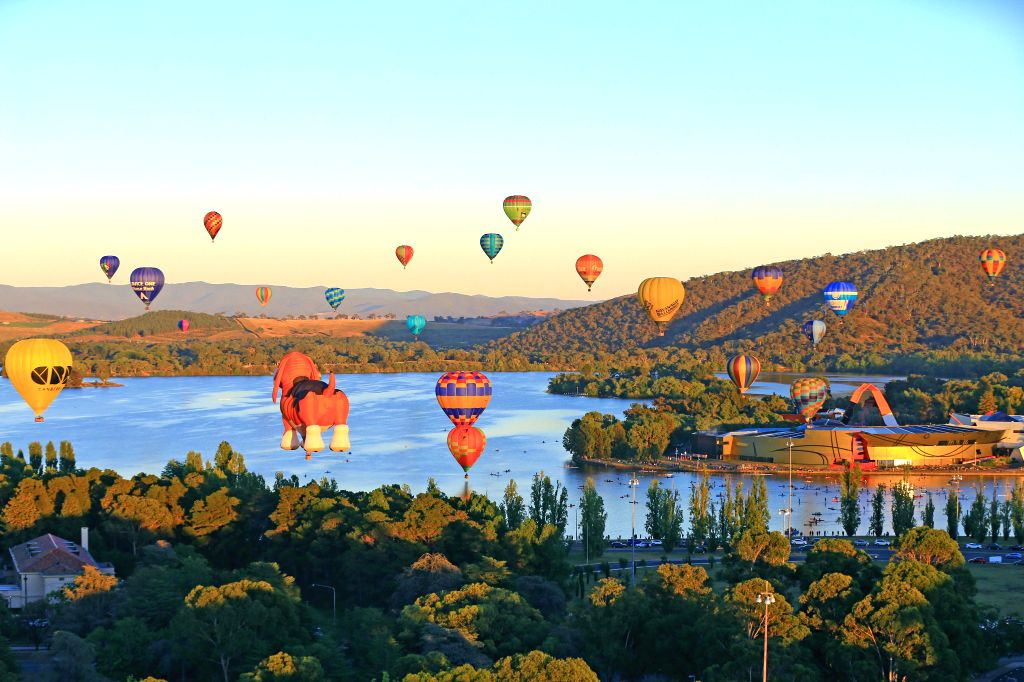CANBERRA, March 14, 2019 - Hot air balloons fly over Lake Burley Griffin during the Balloon Spectacular in Canberra, Australia, March 12, 2019. The annual Balloon Spectacular, started in 1986, runs ...