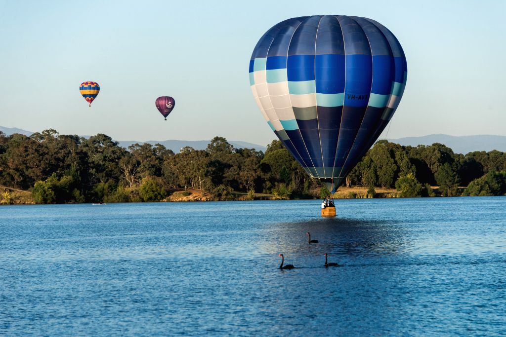 Hot air balloons fly during the Canberra Hot Air Balloon Festival in Canberra, Australia, March 7, 2015.
