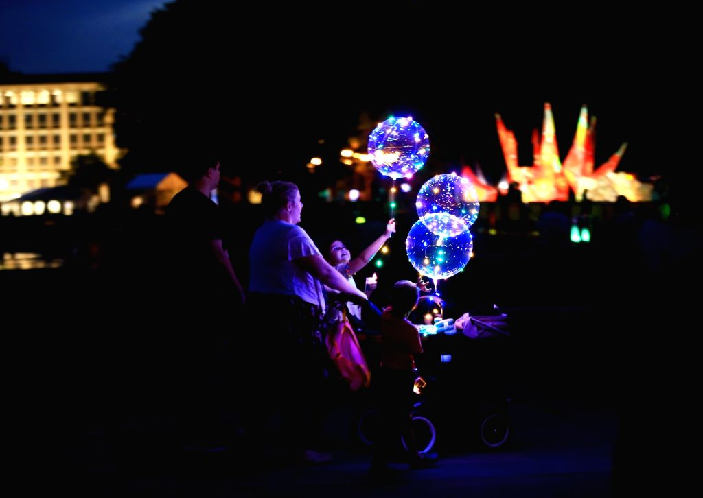 CANBERRA, March 9, 2019 - A family visits the Enlighten Festival in Canberra, Australia, on March 8, 2019. Canberra's annual Enlighten Festival will run from March 1 to 17 this year.
