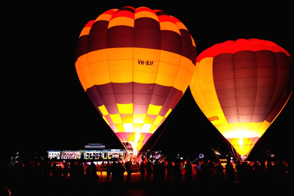 CANBERRA, March 9, 2019 - Hot air balloons attract a crowd of visitors during the Enlighten Festival in Canberra, Australia, on March 8, 2019. Canberra's annual Enlighten Festival will run from March ...