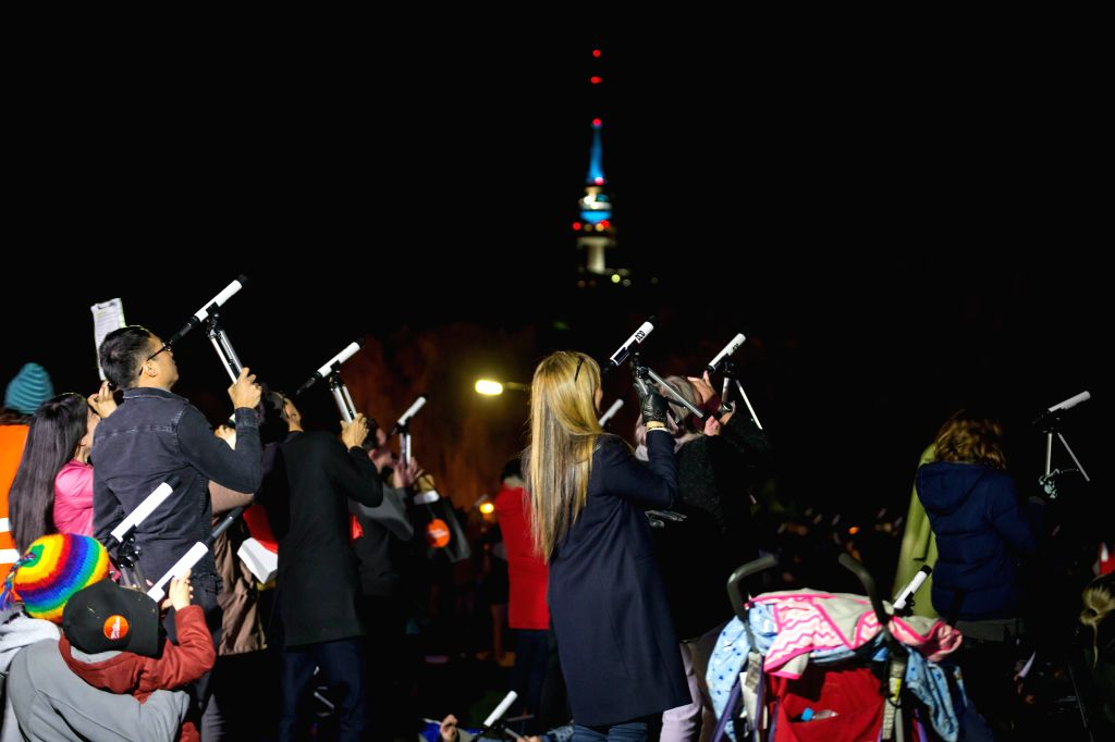 CANBERRA, May 25, 2018    Stargazers look through telescopes in Canberra, Australia, May 23, 2018. Australia has received Guinness World Record certificate for the most people simultaneously ...