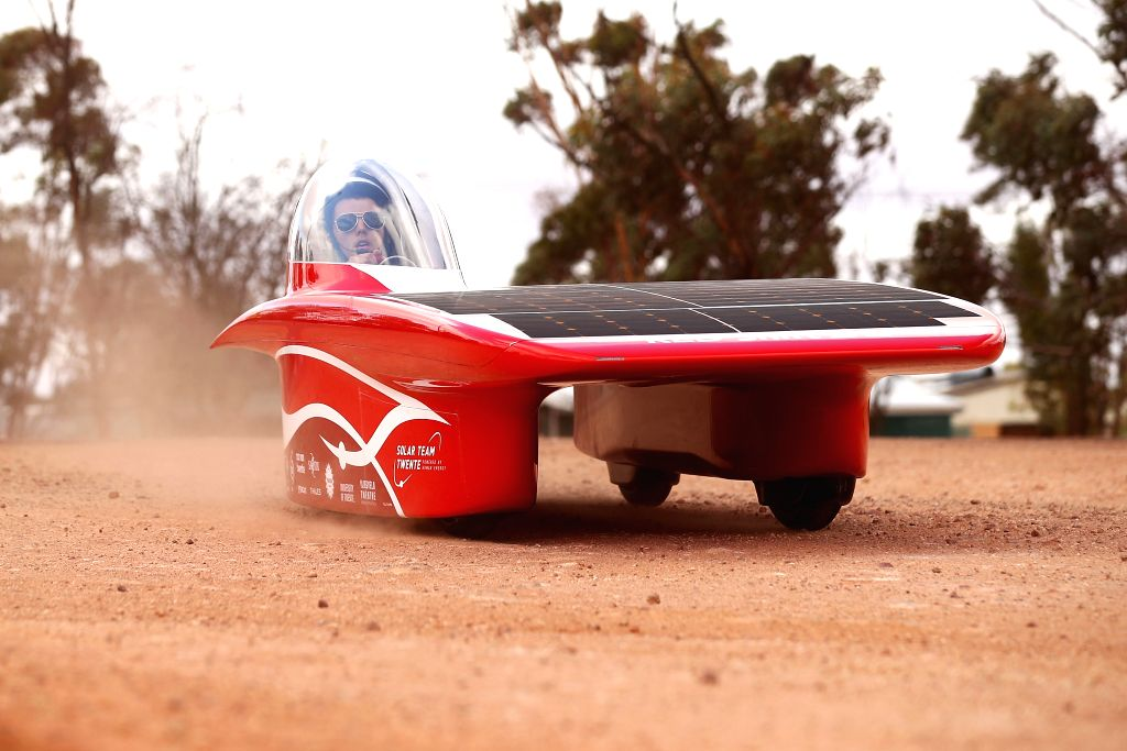 CANBERRA, Oct. 11, 2017 - Team Twente solar vehicle Red Shift from the Netherlands enters the control stop in Coober Pedy, a South Australian town known as the Opal Capital, during the fourth day ...
