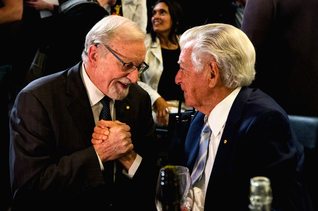 """CANBERRA, Oct. 4, 2017 - Former Australian Prime Minister Bob Hawke (R) talks with Former Australian Foreign Minister Gareth Evans after an event launching Evans' new book """"Incorrigible ... - Bob Hawke"""