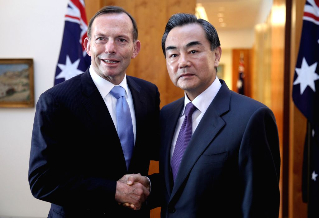 Australian Prime Minister Tony Abbott (L) meets with Chinese Foreign Minister Wang Yi in Canberra,  capital of Australia, on Sept. 8, 2014.