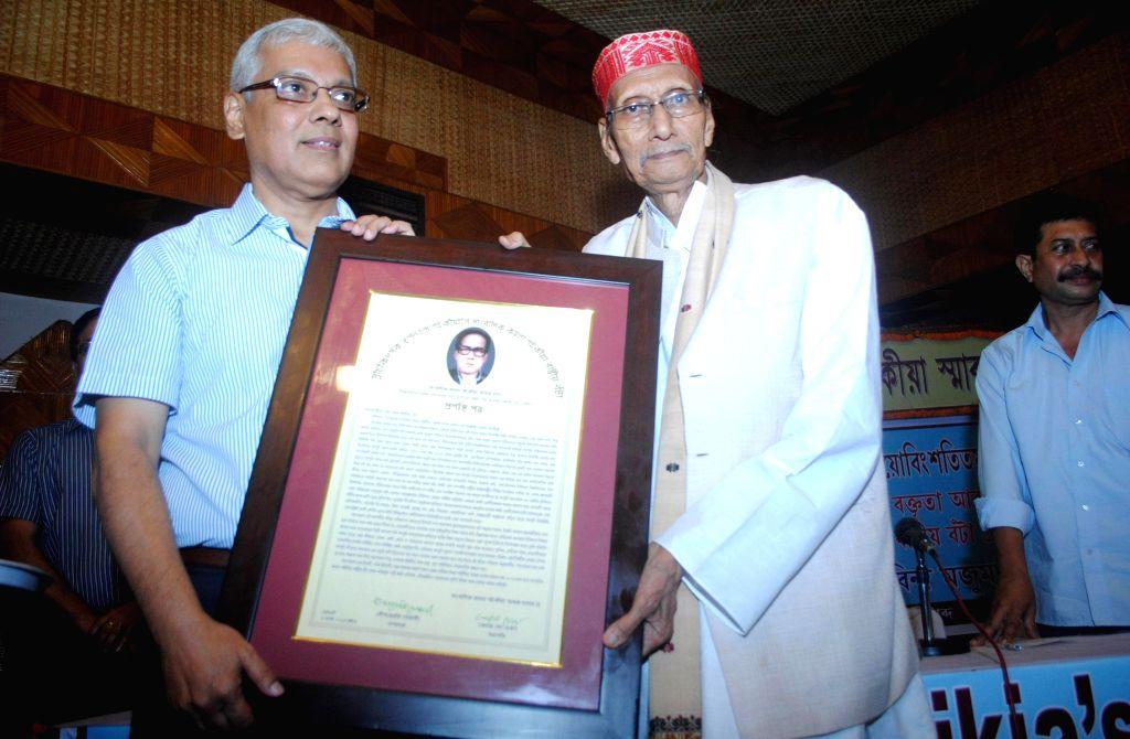 Cancer specialist Dr. Tapan Kumar Saikia, receiving Journalist Kamala Saikia national award from former Sahitya Sabha President and senior journalist Kanak Sen Deka on the occasion of Kamala Saikia's - Tapan Kumar Saikia