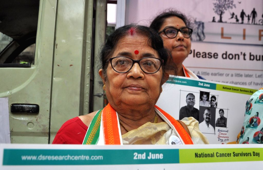 Cancer survivors participate in an awareness drive on the eve of National Cancer Survivors Day, in Kolkata on June 1, 2019.