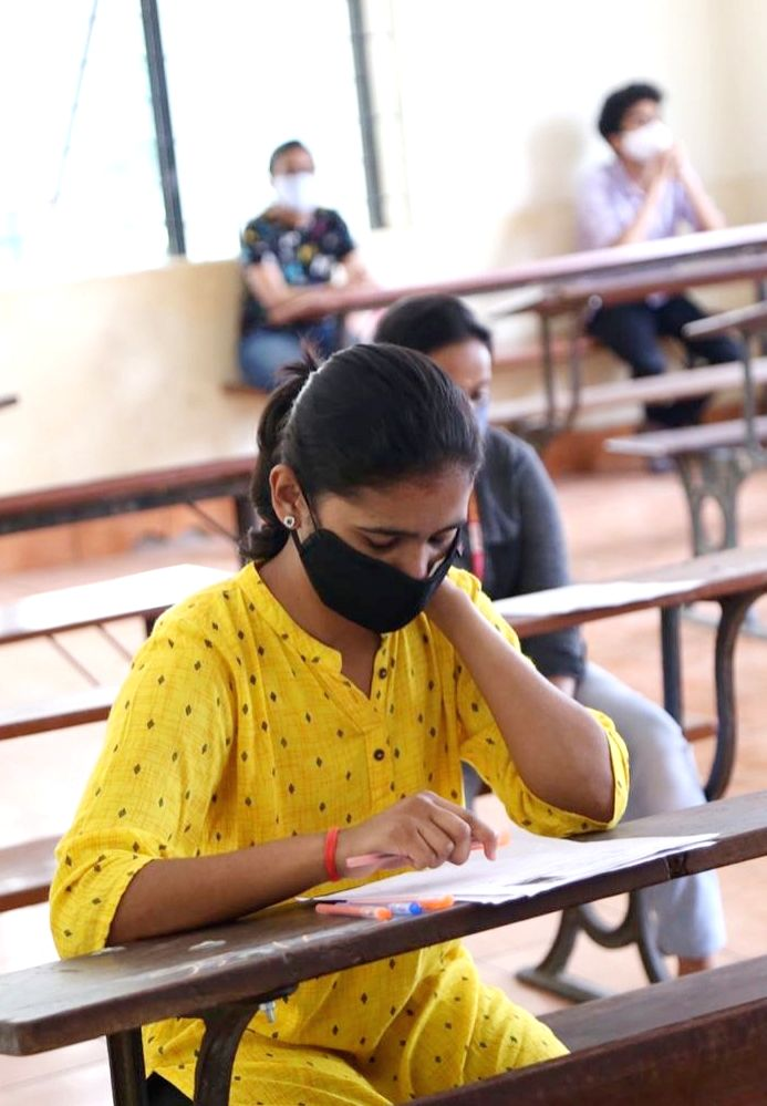 Candidates appear for the Common Entrance Test (CET) examinations at SSMRV college in Bengaluru on July 30, 2020.