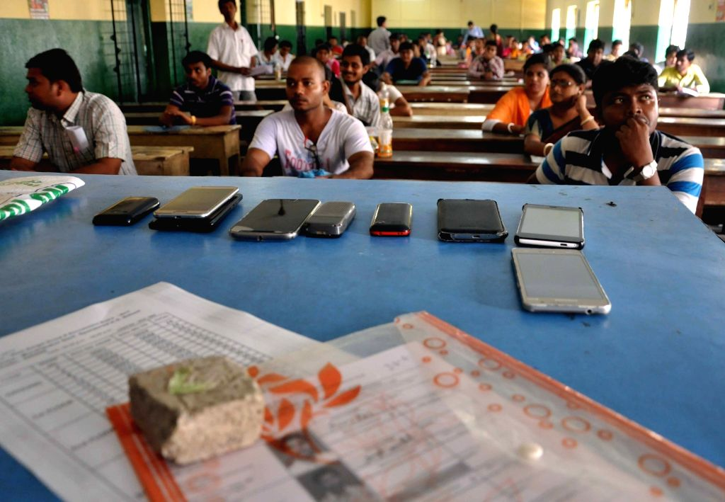 Candidates appear in a competitive written examination for 6,000 Group D posts of the West Bengal government, in Kolkata on May 20, 2017.