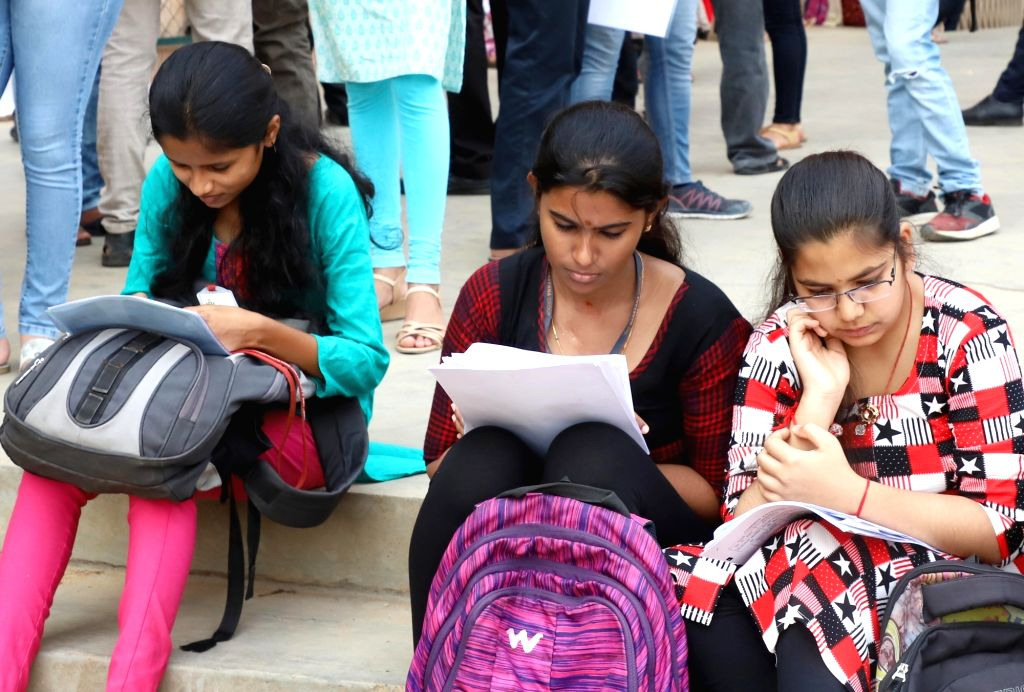 Candidates busy in last-minute preparations as they wait to appear for the Common Entrance Test (CET) examination at an exam center in Bengaluru, on April 29, 2019.