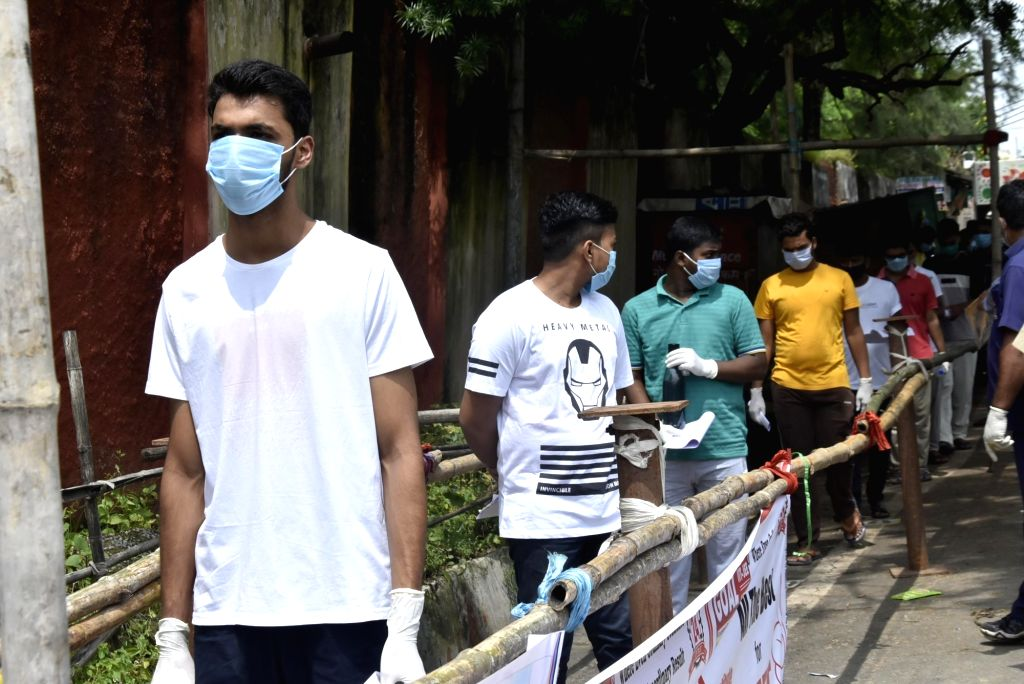 Candidates maintain social distance amid Covid 19 pandemic during their entry at examination centre for National Eligibility cum Entrance Test (NEET) exam in Ranchi on Sunday, September 13, ...
