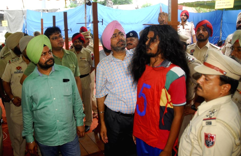 Candidates undergo physical measurement tests during a Punjab Police Recruitment drive in Amritsar on July 27, 2016.