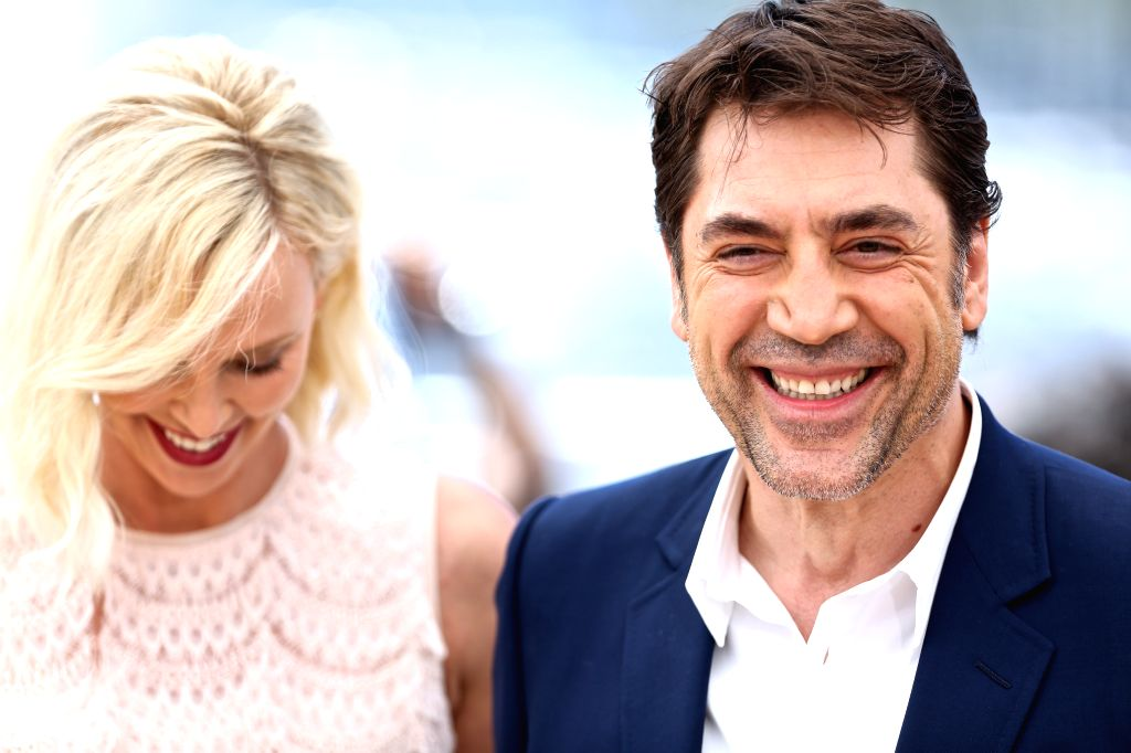 """CANNES (FRANCE), May 20, 2016 Cast members Charlize Theron (L) and Javier Bardem pose during a photocall for the film """"The Last Face"""" in competition at the 69th Cannes Film ..."""