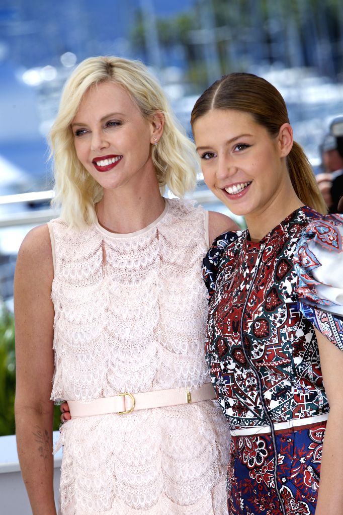 """CANNES (FRANCE), May 20, 2016 Cast members Charlize Theron (L) and Adele Exarchopoulos pose during a photocall for the film """"The Last Face"""" in competition at the 69th Cannes ..."""