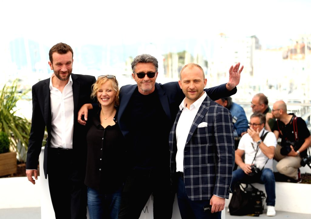 """CANNES, May 11, 2018 - Actor Tomasz Kot, actress Joanna Kulig, director Pawel Pawlikowski and actor Borys Szyc attend the photocall for """"Cold War"""" during the 71st annual Cannes Film ... - Tomasz Kot"""
