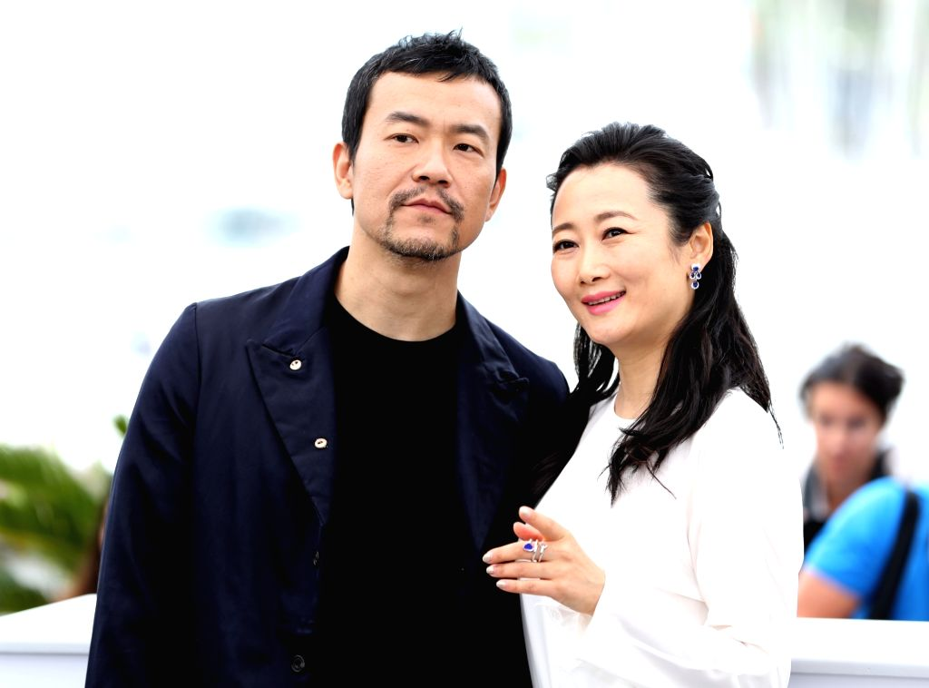 """CANNES, May 12, 2018 - Chinese actor Liao Fan (L), Chinese actress Zhao Tao of the Chinese film in competition, """"Ash is Purest White"""", pose during a photocall of the 71st Cannes ... - Liao Fan"""