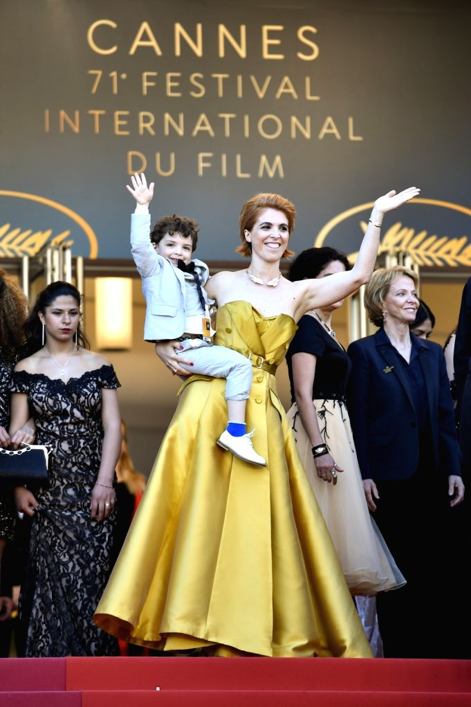 """CANNES, May 12, 2018 - French director Eva Husson (front) poses on the red carpet during the premiere of the film """"Girls of the Sun""""  at the 71st Cannes International Film Festival in ... - Eva Husson"""