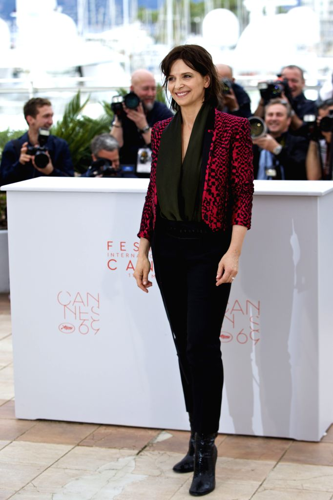 """CANNES, May 13, 2016 - Cast member Juliette Binoche poses during a photocall for the film """"Ma Loute"""" (Slack Bay) during the 69th Cannes Film Festival in Cannes, France, May 13, 2016."""