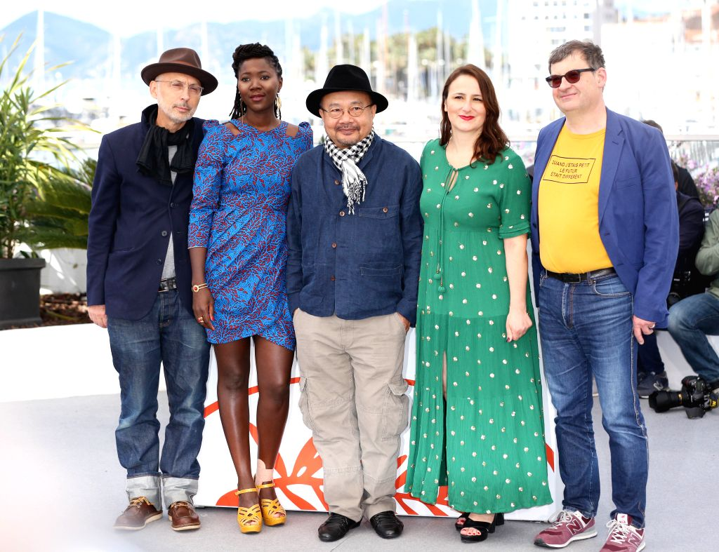 CANNES, May 15, 2019 - President of the Camera d'Or Jury and Cambodian director Rithy Panh (C), together with other jury members Benoit Delhomme (1st L), Alice Diop (2nd L), Sandrine Marques (2nd R) ... - Rithy Panh