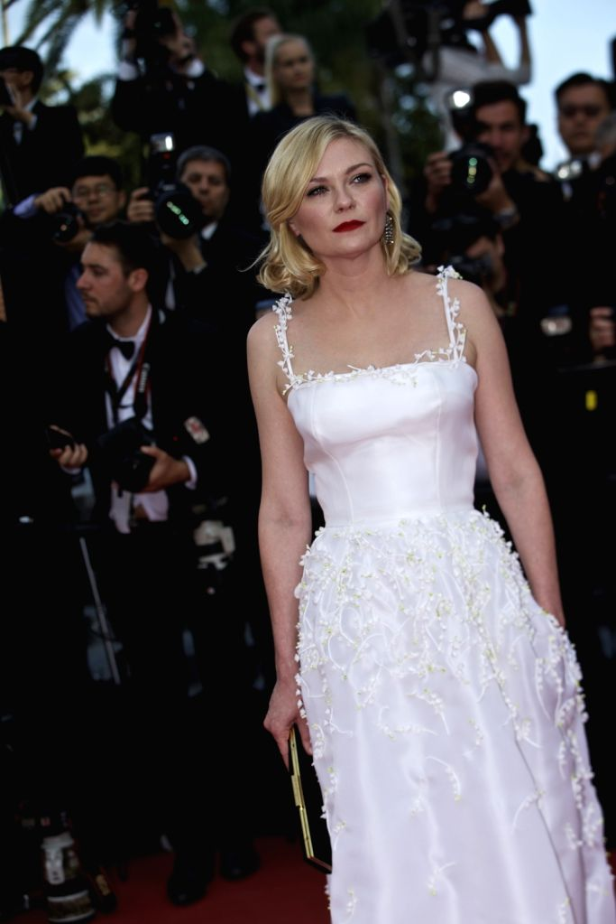 """CANNES, May 16, 2016 - Jury member actress Kirsten Dunst poses on the red carpet as she arrives for the screening of film """"Loving"""" in competition at the 69th Cannes Film Festival in Cannes, ... - Kirsten Dunst"""