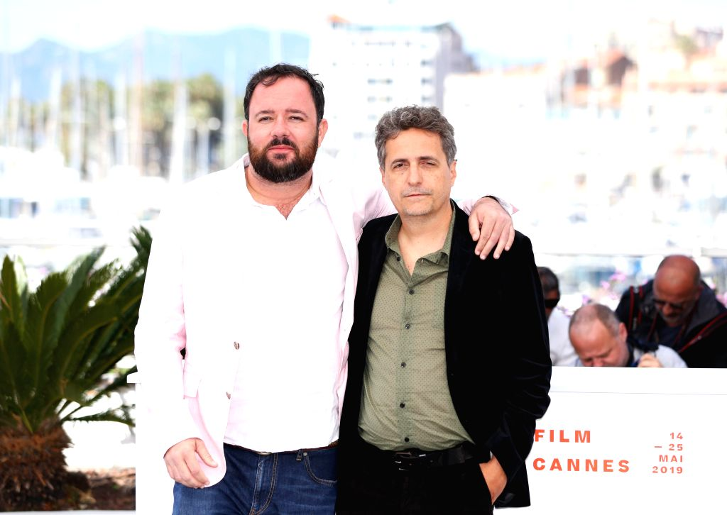 "CANNES, May 16, 2019 - Brazilian directors Juliano Dornelles (L) and Kleber Mendonca Filho pose during a photocall for the film ""Bacurau"" at the 72nd Cannes Film Festival in Cannes, France, ..."
