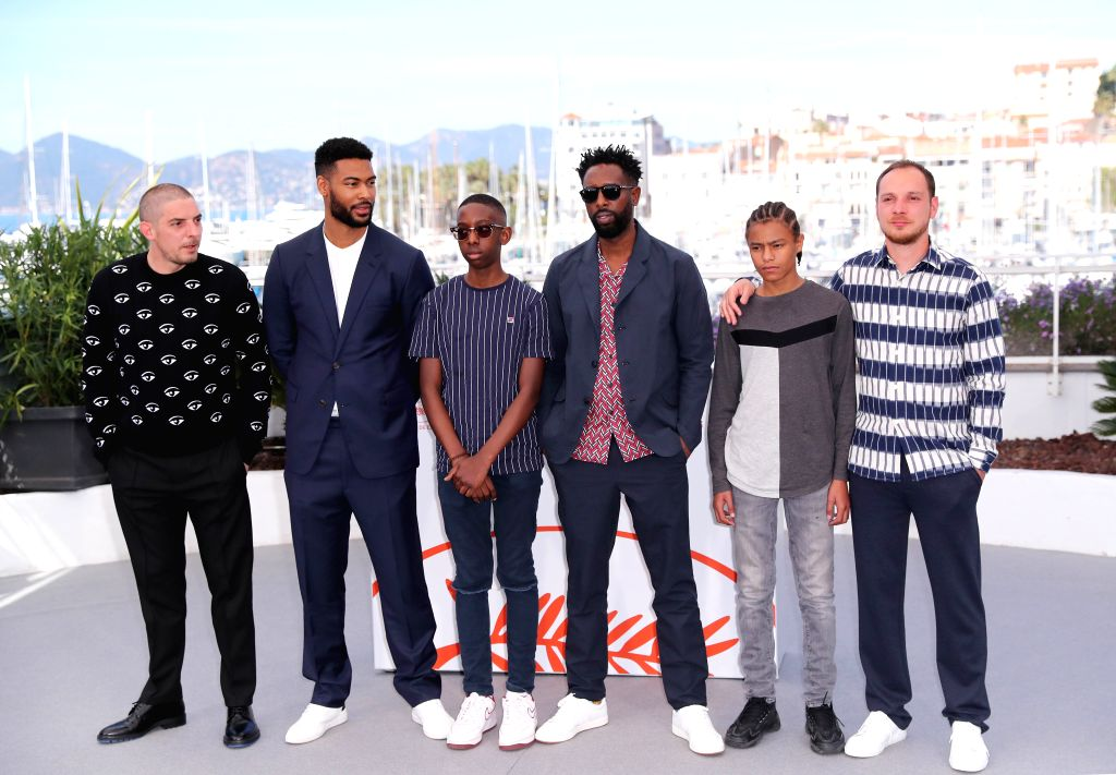 """CANNES, May 16, 2019 - Cast members of """"Les Miserables"""" pose during a photocall at the 72nd Cannes Film Festival in Cannes, France, May 16, 2019. French director Ladj Ly's film """"Les ... - Ladj L"""