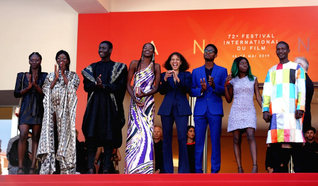 """CANNES, May 16, 2019 - French director Mati Diop (4th R) and cast members attend the premiere of the film """"Atlantics"""" during the 72nd Cannes Film Festival in Cannes, France, May 16, 2019. ... - Mati Diop"""