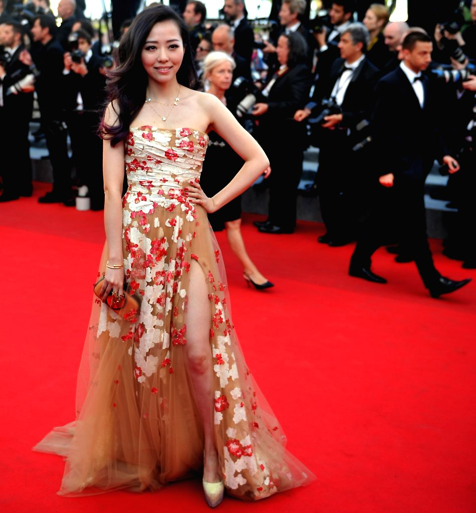 """Chinese singer Zhang Liangying poses as she arrives for the screening of the film """"Le Meraviglie"""" at the 67th edition of the Cannes Film Festival in Cannes,"""
