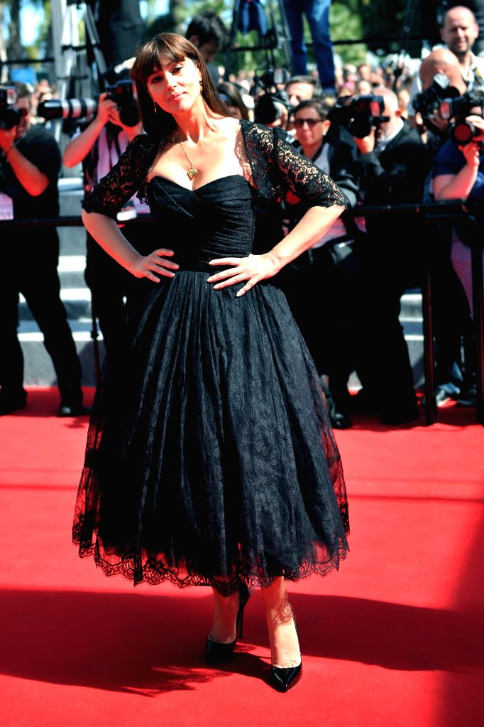 """Italian actress Monica Bellucci poses as she arrives for the screening of the film """"Le Meraviglie"""" at the 67th edition of the Cannes Film Festival in ... - Monica Bellucci"""