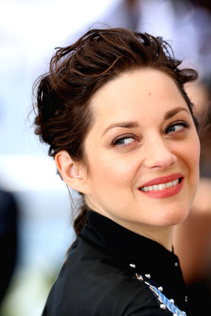 """CANNES, May 19, 2016 - Actress Marion Cotillard poses during a photocall for the film """"Juste la fin du monde"""" (It's Only the End of the World) in competition at the 69th Cannes Film ... - Marion Cotillard"""
